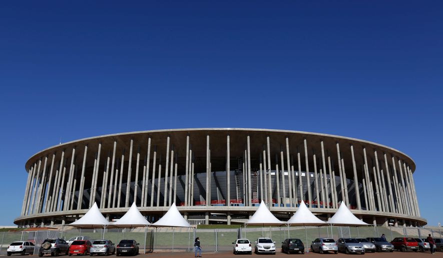 FILE - This April 29, 2014 file photo, shows the Mane Garrincha Stadium in Brasilia, Brazil. Brazil spent billions renovating and building World Cup stadiums that were supposed to help modernize and improve local soccer. Almost a year after the tournament ended, the nation is still trying to figure out what to do with them. Some of the 12 new state-of-the-art stadiums are just now being completed as originally planned. Others are already up for sale. (AP Photo/Eraldo Peres, File)