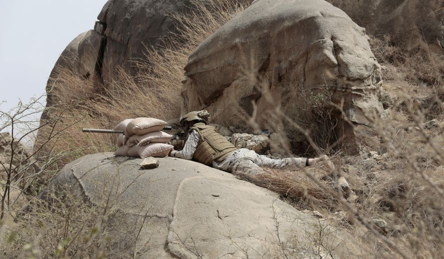 "FILE - In thos Monday, April 20, 2015 file photo, a Saudi soldier aims machine-gun from behind sandbag barricade in the border with Yemen in Jazan, Saudi Arabia. A cross-border attack on Saudi Arabia by Yemeni rebel forces resulted in late-night clashes on Thursday, April 30, 2015 that left three Saudi soldiers and ""dozens"" of Yemeni rebels dead, according to the Saudi Defense Ministry. (AP Photo/Hasan Jamali, File)"