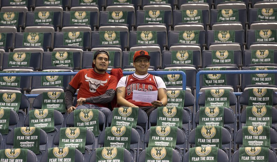 Chicago Bulls fans sit among Fear the Deer towels of the Milwaukee Bucks before Game 6 of an NBA basketball first-round playoff series Thursday, April 30, 2015, in Milwaukee. (AP Photo/Jeffrey Phelps)