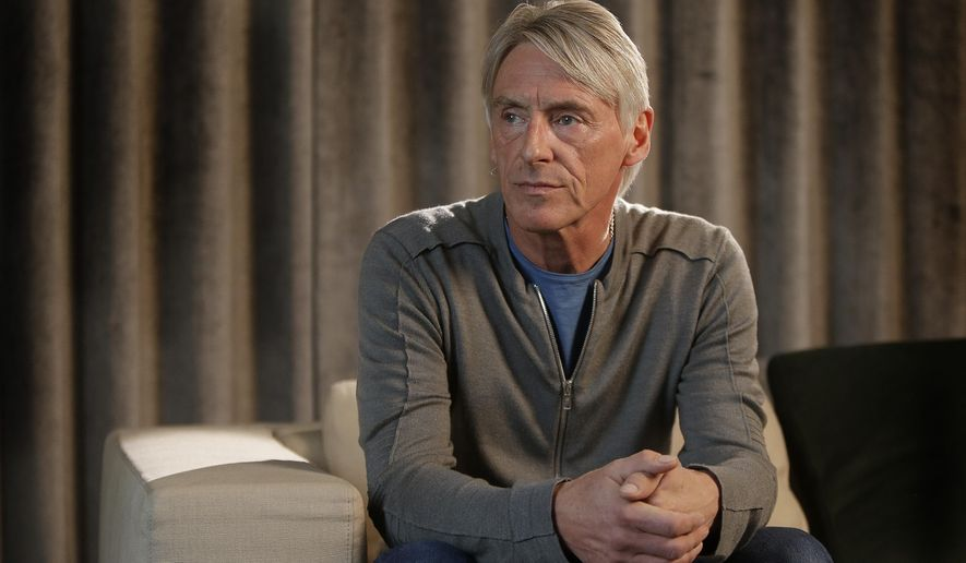 English musician Paul Weller poses for photographs at Parlophone Records in central London, Thursday, 30 April, 2015, ahead of the launch of his new album 'Saturns Pattern', his 12th studio album which will be released on May 18th via Parlophone Records. Amid UK election, Paul Weller says he's fed up with politics. (Photo by Joel Ryan/Invision/AP)