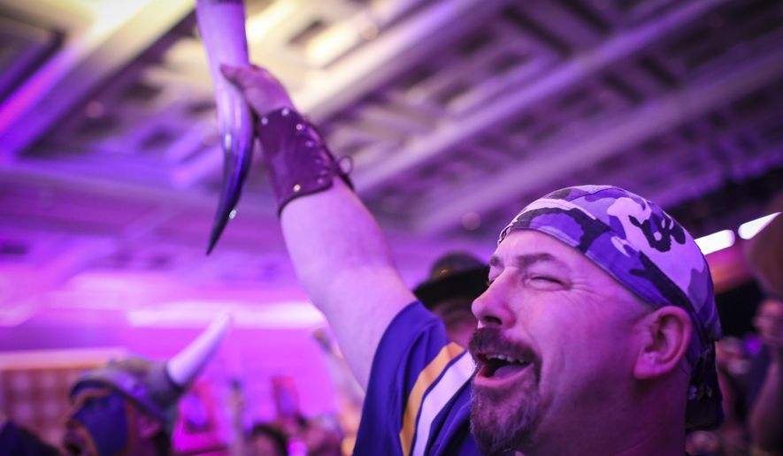 Rustin Banks raises his horn glass to cheer at the Vikings NFL Draft party Wednesday, April 30, 2015 at the Convention Center in Minneapolis, Minn. (Renee Jones Schneider/Star Tribune via AP)  MANDATORY CREDIT; ST. PAUL PIONEER PRESS OUT; MAGS OUT; TWIN CITIES LOCAL TELEVISION OUT