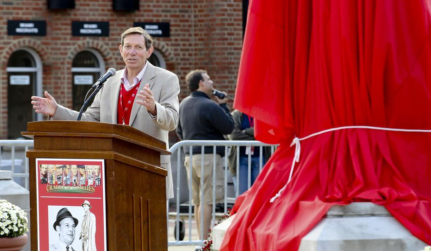 FILE-This Saturday, Sept. 22, 2012 file photo shows David Hodge, president of Miami University, speaking during the unveiling of the new Paul Brown statue in Miami University's Cradle of Coaches Plaza, , in Oxford, Ohio. Hodge says he will retire in 2016, after 10 years leading the school in southwest Ohio. (Nick Daggy/The Journal-News via AP, File)