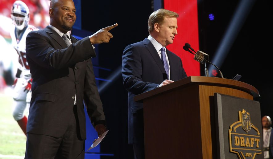 NFL commissioner Roger Goodell speaks before Shaun Williams, left, announces that the New York Giants selects Alabama defensive back Landon Collins as the 33rd pick in the second round of the 2015 NFL Football Draft,  Friday, May 1, 2015, in Chicago. (AP Photo/Charles Rex Arbogast)