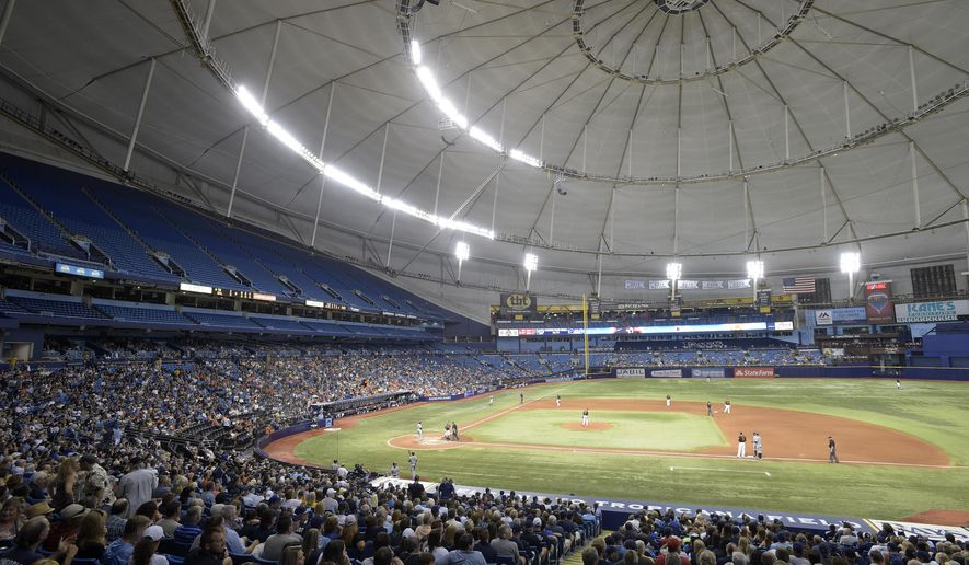 Fans watch as the Tampa Bay Rays and the Baltimore Orioles play during the eighth inning of a baseball game in St. Petersburg, Fla., Friday, May 1, 2015. (AP Photo/Phelan M. Ebenhack)