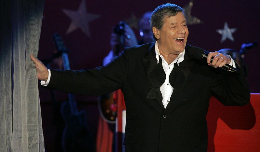 FILE - In this Sept. 5, 2005 file photo, longtime host Jerry Lewis performs during the Muscular Dystrophy Association telethon in Beverly Hills, Calif.  MDA said Friday, May 1, 2015, that the Labor Day television fundraising tradition for decades, is ending. Celebrities including Frank Sinatra, John Lennon and Michael Jackson to Pitbull and Jennifer Lopez have performed on the telethon, first hosted by Lewis and Dean Martin in 1956. It moved to Labor Day in 1966. (AP Photo/Jae C. Hong, File)