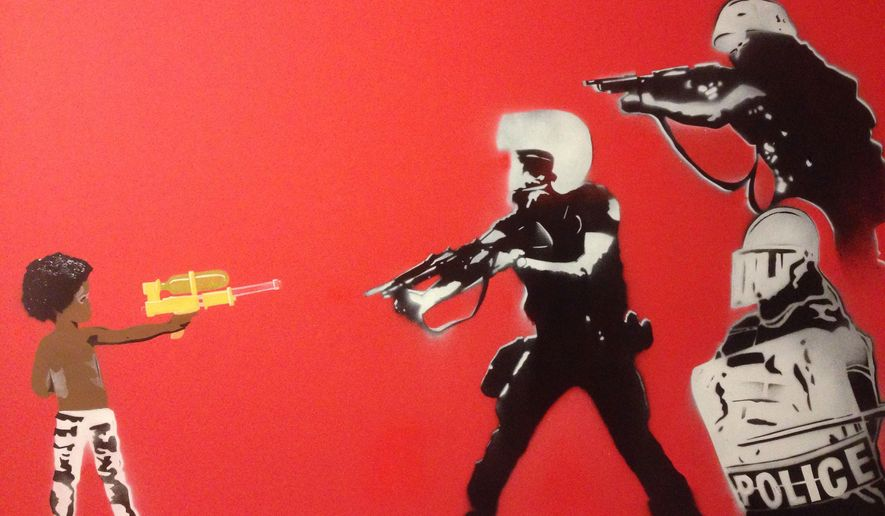 "This photo provided by artist Mike Lroy his artwork titled ""Don't Shoot."" Two labor groups representing police officers in Wisconsin issued a statement saying they object to the work that is on display at the Central branch of the Madison, Wis., Public Library which shows a young African-American boy pointing a toy water gun at three officers in riot gear who are pointing guns back at the child. (Mike Lroy via AP)"
