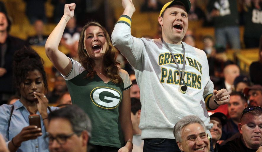 Green Bay Packers fans cheer during the first round of the 2015 NFL Football Draft,  Thursday, April 30, 2015, in Chicago. (AP Photo/Nam Y. Huh)