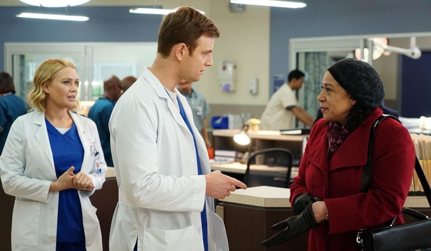 """This photo provided by NBC shows, Laurie Holden, from left, as Dr. Hannah Tramble, Nick Gelfuss as Dr. Will Halstead, and S. Epatha Merkerson as Sharon Goodwin in a scene for the new NBC series drama, Chicago Med."""" (Elizabeth Morris/NBC via AP)"""