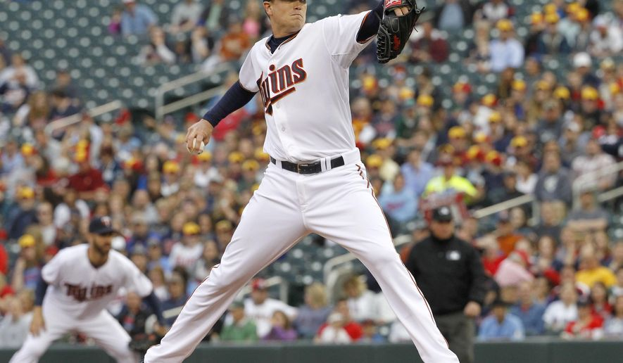 Minnesota Twins starting pitcher Kyle Gibson delivers to the Chicago White Sox during the first inning a baseball game in Minneapolis, Friday, May 1, 2015. (AP Photo/Ann Heisenfelt)