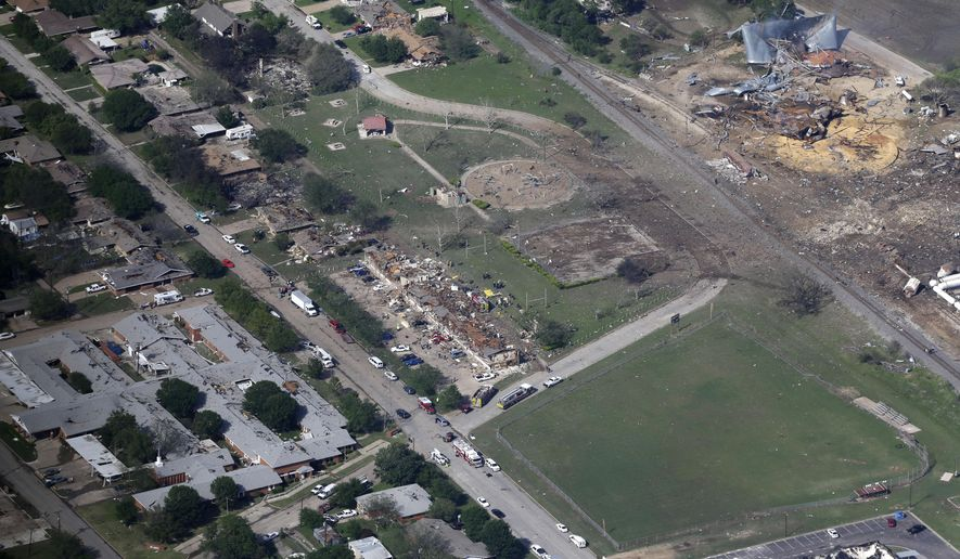 File - This April 18, 2013, file aerial photo shows the remains of a nursing home, left, apartment complex, center, and fertilizer plant, right, destroyed by an explosion in West, Texas. One chamber of the Texas Legislature passed the first measure to regulate the storage of chemicals since the fertilizer plant exploded more than two years ago, killing 15 people and devastating a wide area around the plant. (AP Photo/Tony Gutierrez, File)