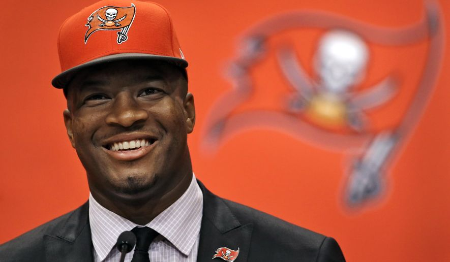 Former Florida State quarterback Jameis Winston, selected as the No.1 overall pick in the NFL draft by the Tampa Bay Buccaneers, smiles during a news conference Friday, May 1, 2015, in Tampa, Fla.  (AP Photo/Chris O'Meara)