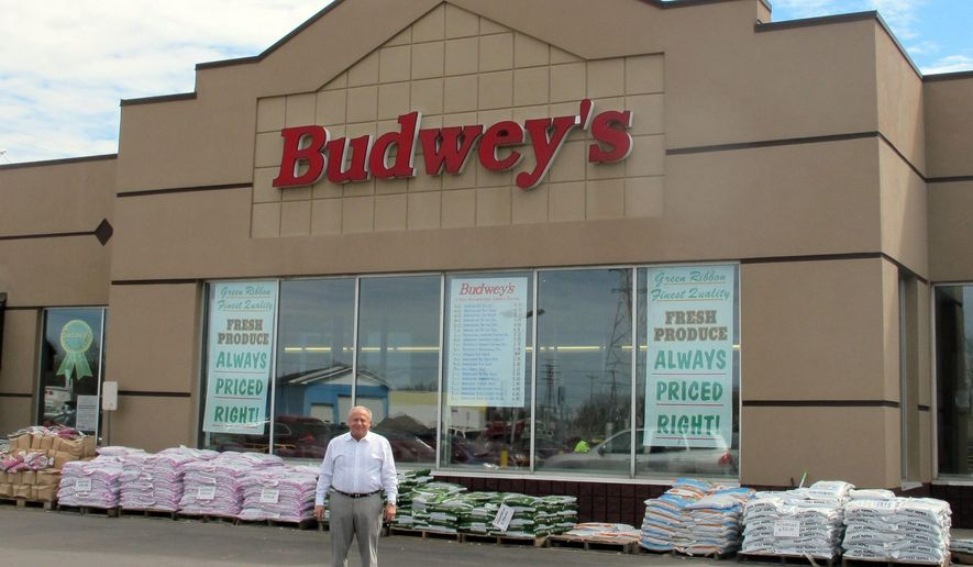 Frank Budwey, 66,  stands outside his family grocery store in North Tonawanda, N.Y., Friday, May 1, 2015. Budwey announced plans Friday to give his 90-year-old store to his employees, starting with 45 percent to be split between 33 full-time workers. His plan is to retire in 10 years and divide the remainder among selected employees. (AP Photo/Carolyn Thompson)