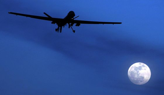 An unmanned U.S. Predator drone flies over Kandahar Air Field, southern Afghanistan in this Jan. 31, 2010, file photo. Nearly three-quarters of Americans say it's acceptable for the U.S. to use unmanned aerial drones to kill an American citizen abroad if that person has joined a terror organization, according to a new Associated Press-GfK poll. (AP Photo/Kirsty Wigglesworth, File)