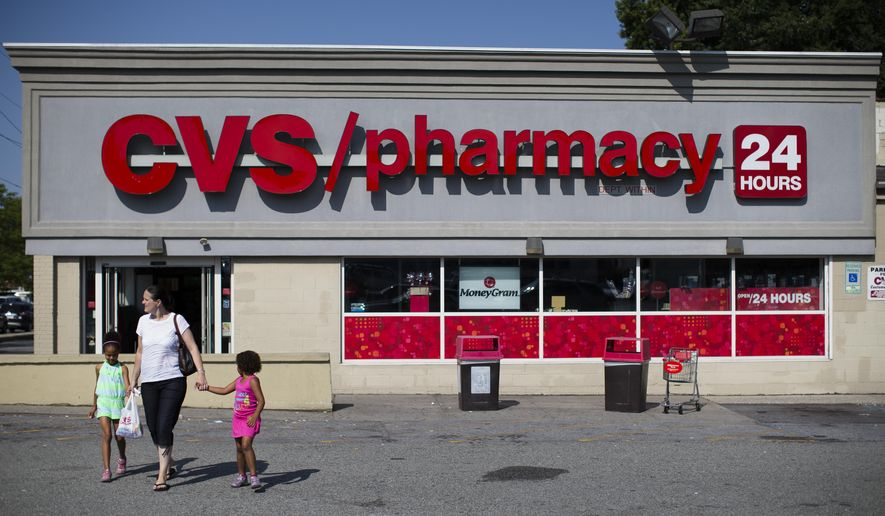 FILE - In this Aug. 7, 2014 file photo, shoppers leave a CVS pharmacy in the Staten Island borough of New York. CVS Health reports quarterly financial results Friday, May 1, 2015. (AP Photo/John Minchillo, File)