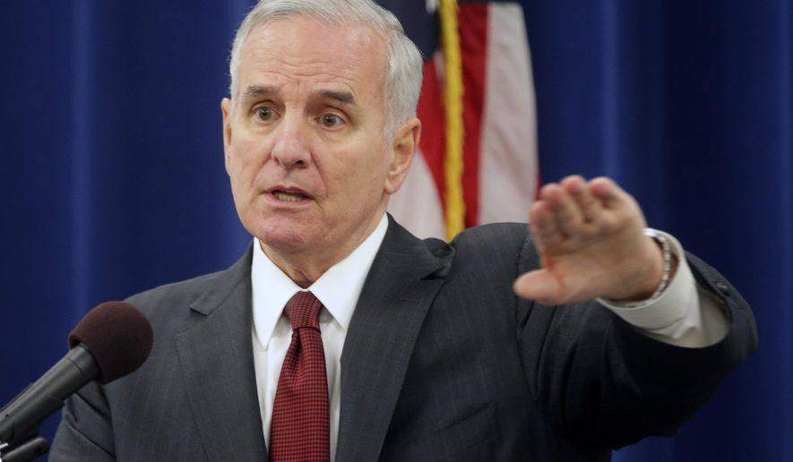 FILE - In this Jan. 9, 2015 file photo, Minnesota Gov.Mark Dayton addresses questions during a post-inaugural news conference in St. Paul, Minn. Minnesota's budget debate moves into the final negotiation stage. (AP Photo/Jim Mone,File)