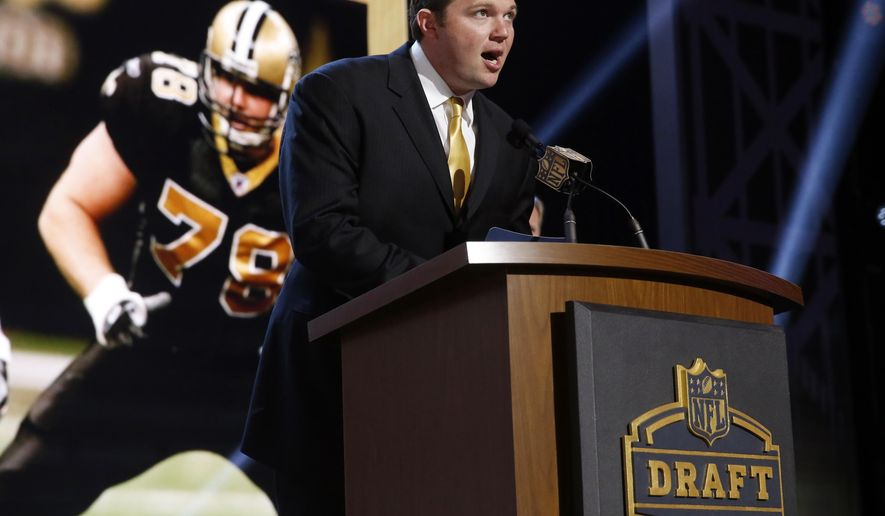 New Orleans Saints offensive tackle Jon Stinchcomb announces that the New Orleans Saints selects Washington linebacker Hau'Oli Kikaha as the 44th pick in the second round of the 2015 NFL Football Draft,  Friday, May 1, 2015, in Chicago. (AP Photo/Charles Rex Arbogast)