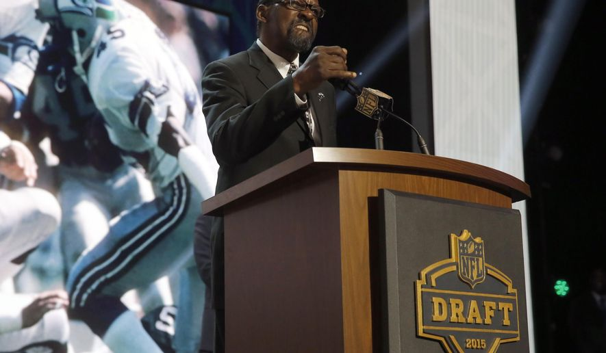 Former Seattle Seahawks safety Kenny Easley announces that the Seahawks selects Michigan defensive lineman Frank Clark as the 63rd pick in the second round of the 2015 NFL Football Draft,  Friday, May 1, 2015, in Chicago. (AP Photo/Charles Rex Arbogast)