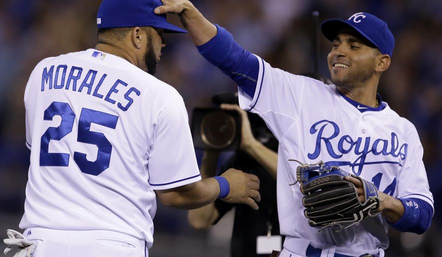 Kansas City Royals second baseman Omar Infante, right, congratulates designated hitter Kendrys Morales (25) following a baseball game against the Detroit Tigers at Kauffman Stadium in Kansas City, Mo., Friday, May 1, 2015. Moralles drove in three-runs in the Royals' victory. The Royals defeated the Tigers 4-1. (AP Photo/Orlin Wagner)