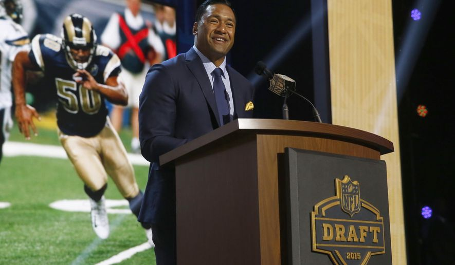 Former NFL player Pisa Tinoisamoa announces the St. Louis Rams selects Wisconsin offensive lineman Rob Havenstein as the 57th pick in the second round of the 2015 NFL Football Draft,  Friday, May 1, 2015, in Chicago. (AP Photo/Charles Rex Arbogast)