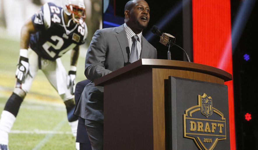 Former New England Patriots cornerback Ty Law announces that the Patriots selects Stanford Jordan Richards as the 64th pick in the second round of the 2015 NFL Football Draft,  Friday, May 1, 2015, in Chicago. (AP Photo/Charles Rex Arbogast)
