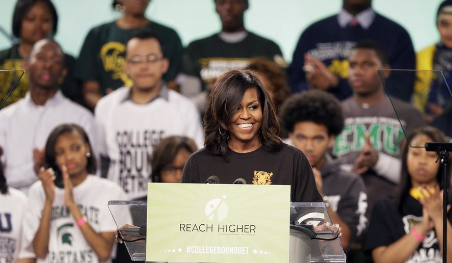 "First lady Michelle Obama speaks at Detroit's first-ever citywide College Signing Day, Friday, May 1, 2015, at Wayne State University in Detroit. The rally is part of her ""Reach Higher"" initiative to encourage American students to commit to education beyond high school. (AP Photo/Carlos Osorio)"
