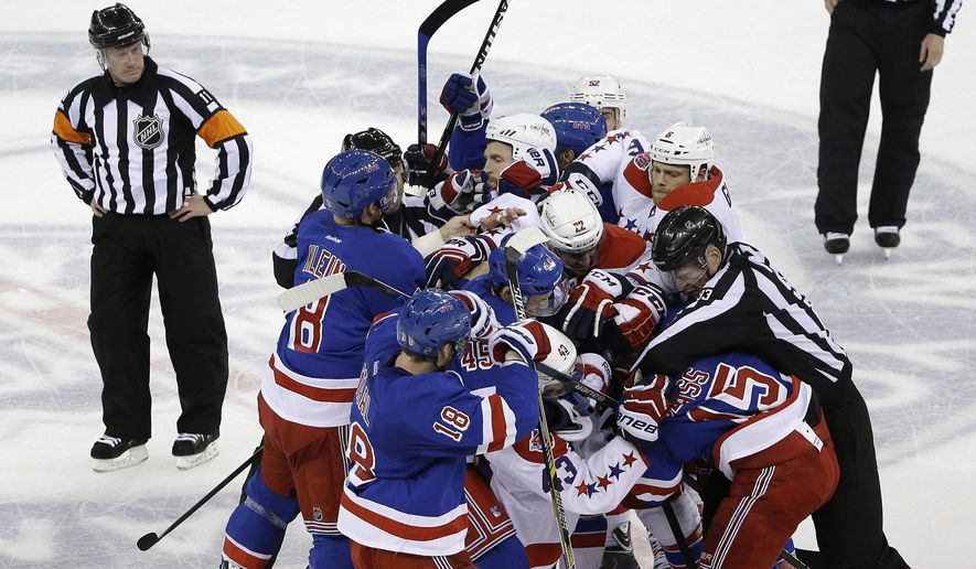 The New York Rangers and the Washington Capitals scuffle at the end of  Game 1 in the second round of the NHL Stanley Cup hockey playoffs Thursday, April 30, 2015, in New York. The Capitals won 2-1. (AP Photo/Frank Franklin II)