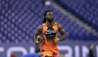 Florida running back Matt Jones runs a drill at the NFL football scouting combine in Indianapolis, Saturday, Feb. 21, 2015. (AP Photo/David J. Phillip)
