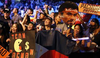 Fans cheer before the Floyd Mayweather Jr. and Manny Pacquiao weigh-in on Friday, May 1, 2015 in Las Vegas. The world weltherweight title fight between Mayweather Jr. and Pacquiao is scheduled for May 2. (AP Photo/John Locher)