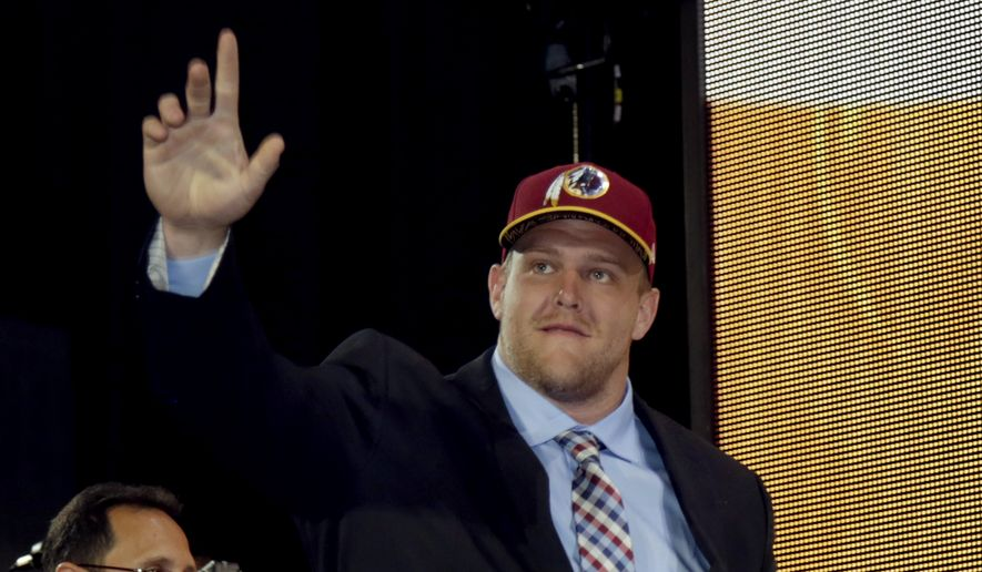 Brandon Scherff walks onto the stage after being drafted fifth by Washington in the first round of the 2015 NFL Draft, Thursday, April 30, 2015, in Chicago.  (Jeff Haynes/AP Images for Panini) **FILE**