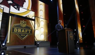 NFL commissioner Roger Goodell announces after the Washington Redskins selects Iowa offensive lineman Brandon Scherff as the fifth pick in the first round of the 2015 NFL Draft,  Thursday, April 30, 2015, in Chicago. (AP Photo/Charles Rex Arbogast)