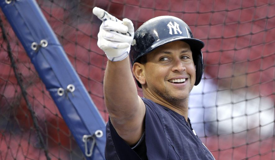 New York Yankees designated hitter Alex Rodriguez gestures at the batting cage prior to a baseball game against the Boston Red Sox at Fenway Park in Boston, Friday, May 1, 2015. (AP Photo/Elise Amendola)
