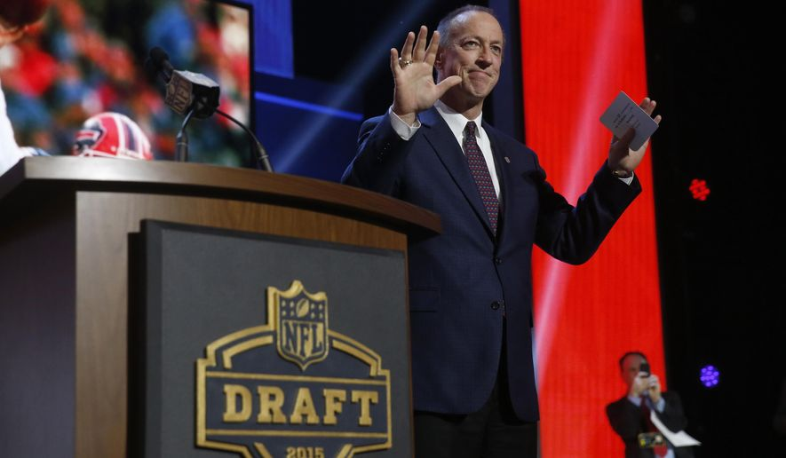 NFL Hall of Famer and Buffalo Bill Quarterback Jim Kelly announces that the Buffalo Bills selects Florida State defensive back Ronald Darby as the 50th pick in the second round of the 2015 NFL Football Draft,  Friday, May 1, 2015, in Chicago. (AP Photo/Charles Rex Arbogast)