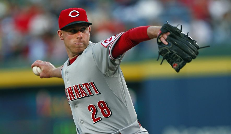Cincinnati Reds starting pitcher Anthony DeSclafani works in the first inning of a baseball game against the Atlanta Braves Friday, May 1, 2015, in Atlanta. (AP Photo/John Bazemore)