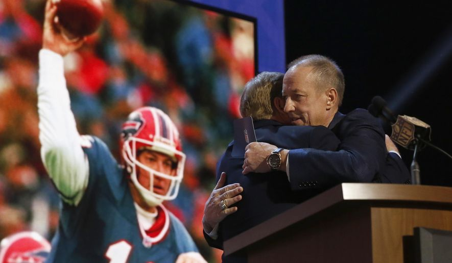 NFL Hall of Famer and Buffalo Bill Quarterback Jim Kelly hugs NFL commissioner Roger Goodell before he announces that the Buffalo Bills selects Florida State defensive back Ronald Darby as the 50th pick in the second round of the 2015 NFL Football Draft,  Friday, May 1, 2015, in Chicago. (AP Photo/Charles Rex Arbogast)