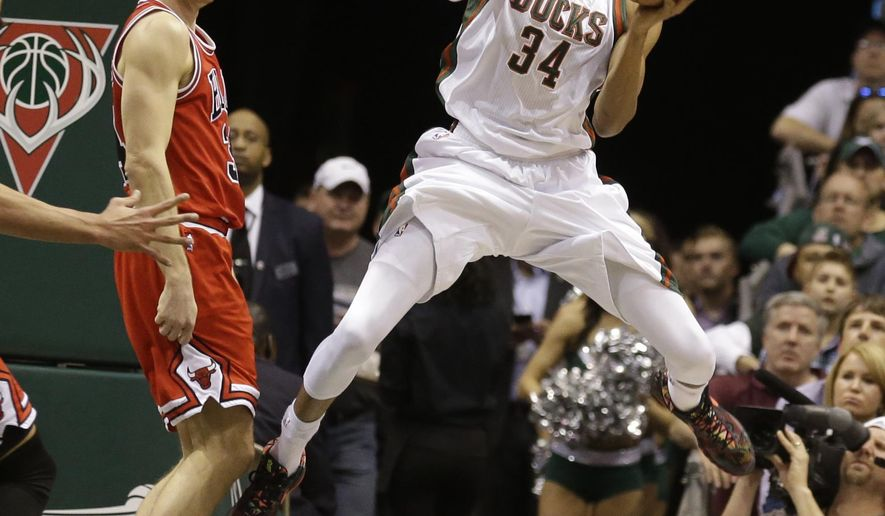 Milwaukee Bucks' Giannis Antetokounmpo (34) looks to pass against the Chicago Bulls' Mike Dunleavy during the first half of Game 6 of an NBA basketball first-round playoff series Thursday, April 30, 2015, in Milwaukee. (AP Photo/Jeffrey Phelps)