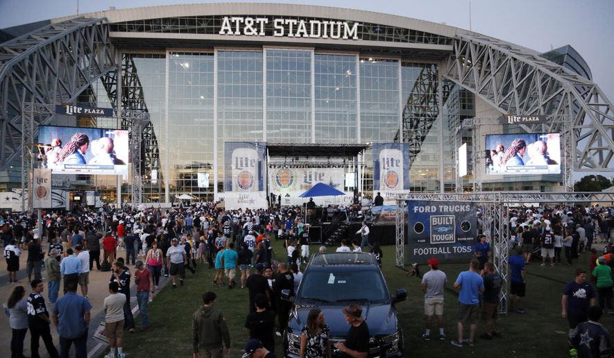 Cowboys fans gather outside AT&T stadium to watch the NFL Draft during the Cowboys draft party in Arlington, Texas, Thursday, April 30, 2015. (Kye R. Lee/The Dallas Morning News via AP)
