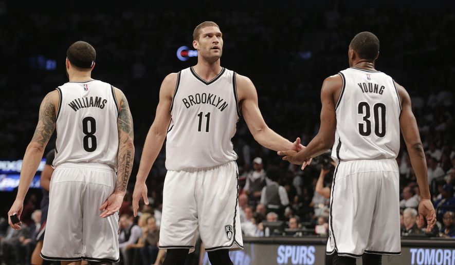 Brooklyn Nets' Brook Lopez (11) reacts with teammates Thaddeus Young (30) and Deron Williams (8) during the second half of Game 6 against the Atlanta Hawks in a first round NBA playoff basketball game Friday, May 1, 2015, in New York. The Hawks won the game 111-87. (AP Photo/Frank Franklin II)