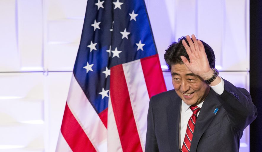 Japanese Prime Minister Shinzo Abe waves during a luncheon meeting at the Millennium Biltmore Hotel in Los Angeles Friday, May 1, 2015. (Mario Anzuoni/Pool via AP)