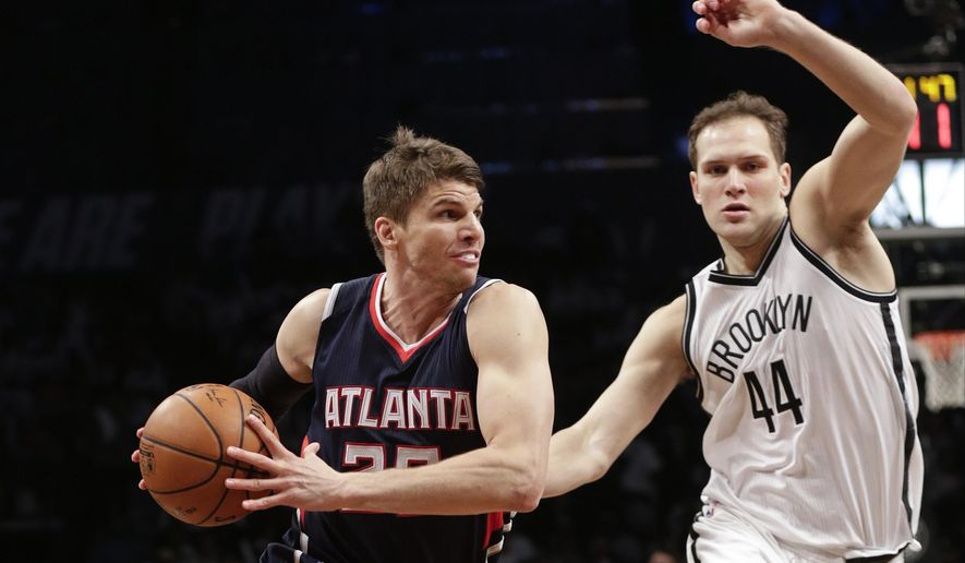 Atlanta Hawks' Kyle Korver (26) drives past Brooklyn Nets' Bojan Bogdanovic (44), of Croatia, during the second half of Game 6 in a first round NBA playoff basketball game Friday, May 1, 2015, in New York. The Hawks won the game 111-87. (AP Photo/Frank Franklin II)