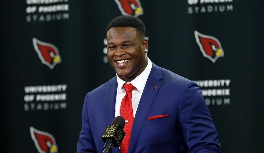 Arizona Cardinals' first-round draft pick D.J. Humphries smiles after being introduced to the media during an NFL football news conference, Friday, May 1, 2015, in Tempe, Ariz. Humphries, a tackle from Florida, was selected 24th overall Thursday night at the NFL draft. (AP Photo/Matt York)