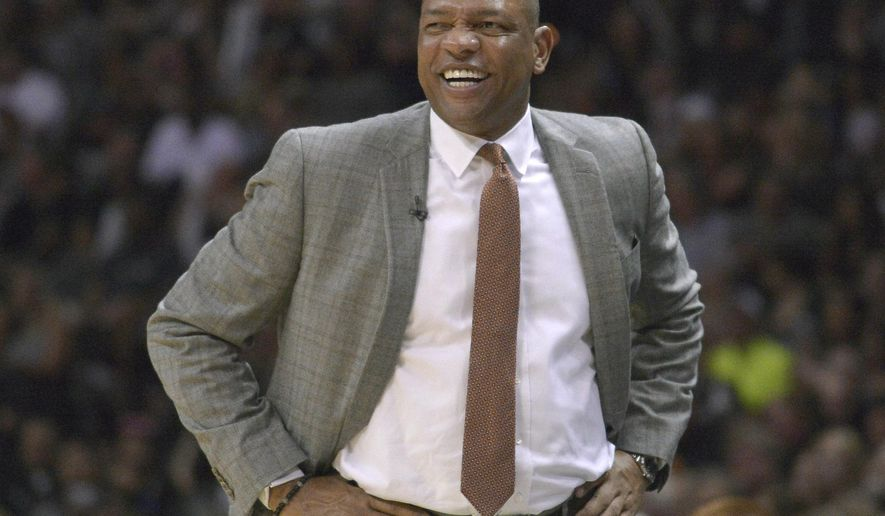 Los Angeles Clippers' Doc Rivers smiles during the second half of Game 6 in an NBA basketball first-round playoff series against the San Antonio Spurs, Friday, May 1, 2015, in San Antonio. Los Angeles won 102-96. (AP Photo/Darren Abate)