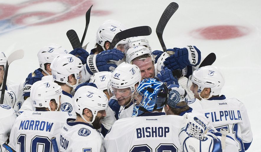 Players from the Tampa Bay Lightning celebrate teammate Nikita Kucherov's winning goal against the Montreal Canadiens during the second overtime of Game 1 of second-round playoff NHL hockey action Friday, May 1, 2015, in Montreal. (Graham Hughes/The Canadian Press via AP) MANDATORY CREDIT