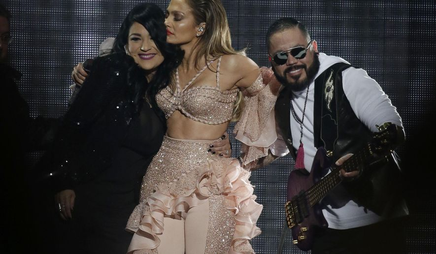 Jennifer Lopez hugs Suzette Quintanilla and A.B. Quintanilla, siblings of slain slinger Selena, during the Latin Billboard Awards Thursday, April 30, 2015, in Coral Gables, Fla. Lopez performed with Selena's band, which included the two siblings. (AP Photo/Lynne Sladky)
