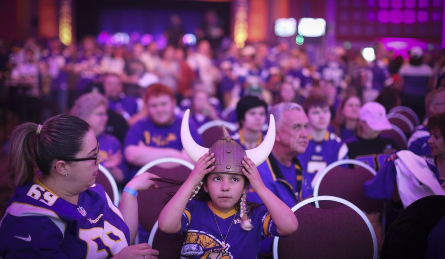 Lizbeth Ortiz, 7, positioned her horns as she watched the draft with her mom Hilda Ortiz at the Vikings NFL Draft party Wednesday, April 30, 2015 at the Convention Center in Minneapolis, Minn. (Renee Jones Schneider/Star Tribune via AP)  MANDATORY CREDIT; ST. PAUL PIONEER PRESS OUT; MAGS OUT; TWIN CITIES LOCAL TELEVISION OUT