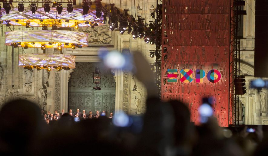People take pictures during the Expo 2015 inaugural concert in Milan, Italy, Thursday, April 30, 2015. Milan's Expo 2015 world's fair has heady ambitions, the biggest of which is to devise a plan to feed the planet as it brings together 145 nations to focus on food and nutrition. City officials hope the fair, which opens Friday for six months and is expected to attract 20 million visitors, will give Italy's fashion and banking capital a boost in international stature. (AP Photo/Riccardo De Luca)