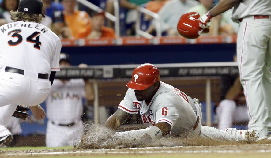 Philadelphia Phillies' Ryan Howard (6) is out as he slides into home plate on a fielder's choice by Miami Marlins' Tom Koehler (34) in the fourth inning of a baseball game, Friday, May 1, 2015, in Miami. (AP Photo/Alan Diaz)