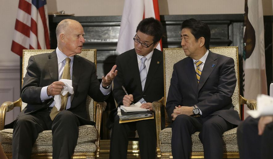 California Gov. Jerry Brown, left, speaks with Japanese Prime Minister Shinzo Abe at the Fairmont Hotel in San Francisco, Thursday, April 30, 2015. (AP Photo/Jeff Chiu, Pool)