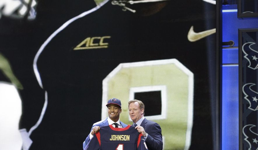Wake Forest defensive back Kevin Johnson poses for photos with NFL commissioner Roger Goodell after being selected by the Houston Texans as the 16th pick in the first round of the 2015 NFL Draft, Thursday, April 30, 2015, in Chicago. (AP Photo/Nam Y. Huh)