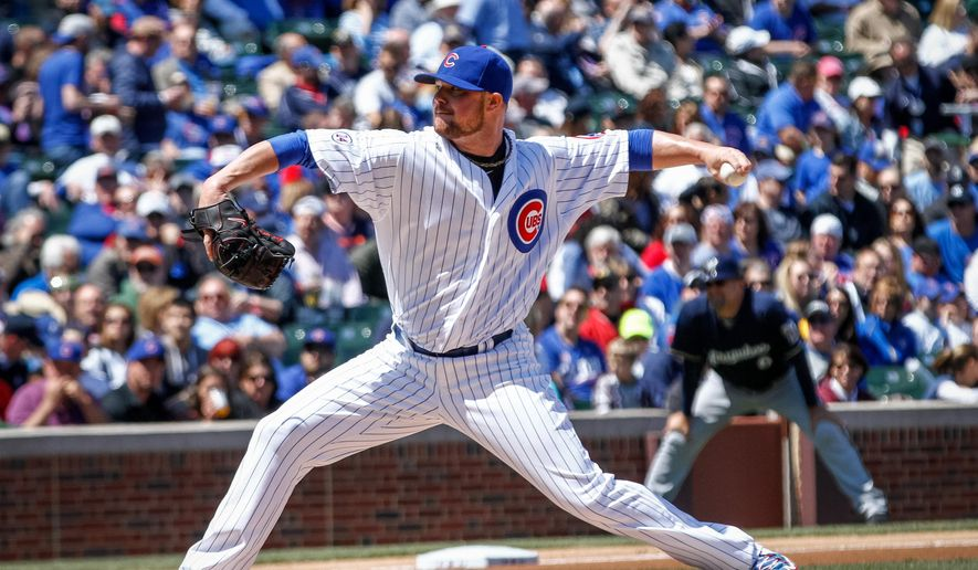 Chicago Cubs starter Jon Lester thows to Milwaukee Brewers' Juan Segura in the first inning of a baseball game in Chicago, Friday May 1, 2015. (AP Photo/Charles Cherney)