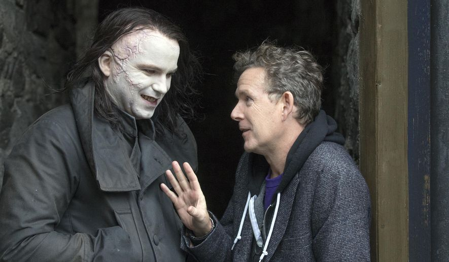 "CORRECTS SPELLING TO RORY KINNEAR - In this photo provided by Showtime, Rory Kinnear, in character as The Creature, left, speaks with John Logan on the set of the television series, ""Penny Dreadful."" Season 2 makes its debut on Showtime Sunday night, May 3, 2015. (Jonathan Hession/Showtime via AP)"